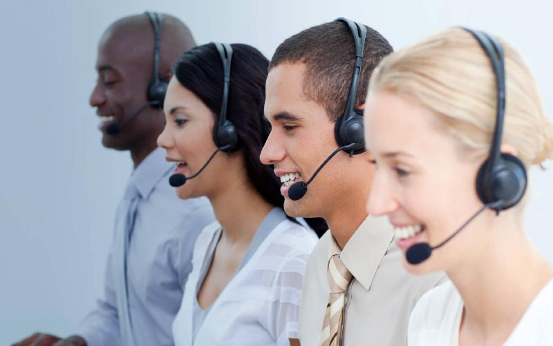 people talking on headsets for support